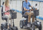 Couple out on mobility scooter side by side